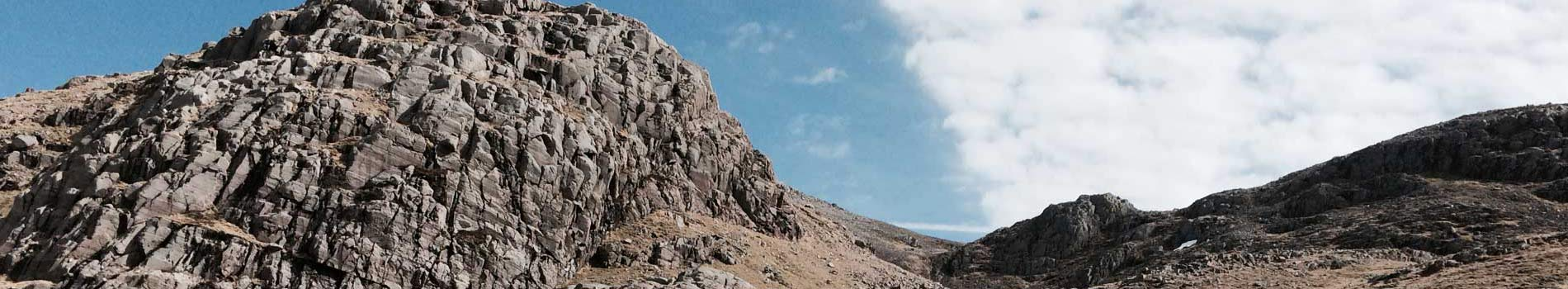 Mountain crags blue sky