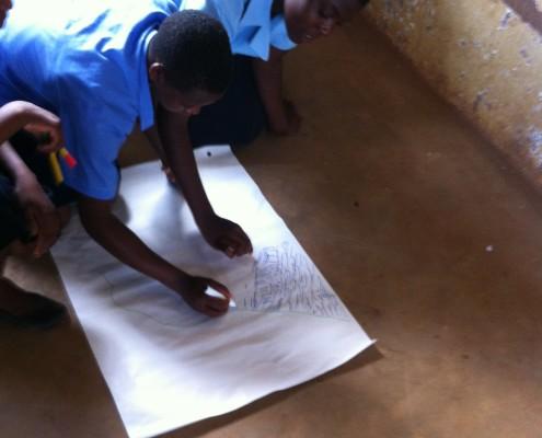Girls in Malawi drawing